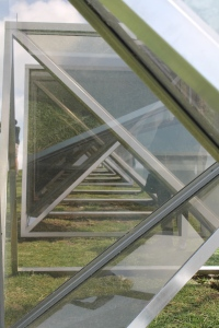 Graham Bennett - Sea / Sky Kaipara looking through the stainless steel and glass units.